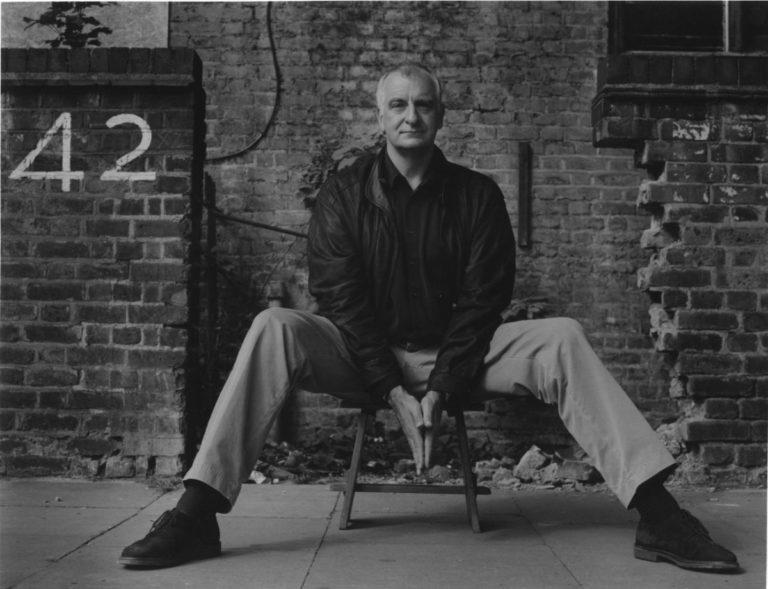 Douglas Adams eats biscuits on Cambridge station